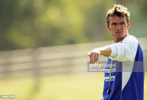 Dean Laidley Coach of the Roos gives instructions to his players during the Kangaroos pre season training session at Arden St Oval on January 25 2005...