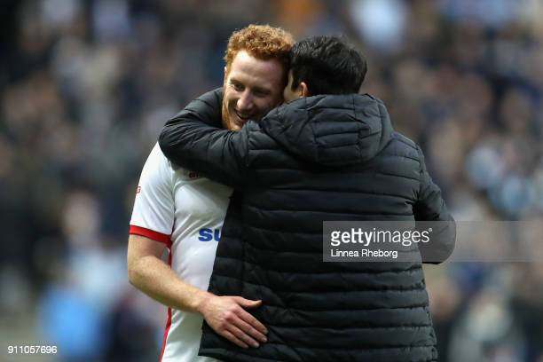 Dean Lewington of Milton Keynes Dons is hugged by manager Dan Micciche after being substituted during The Emirates FA Cup Fourth Round match between...