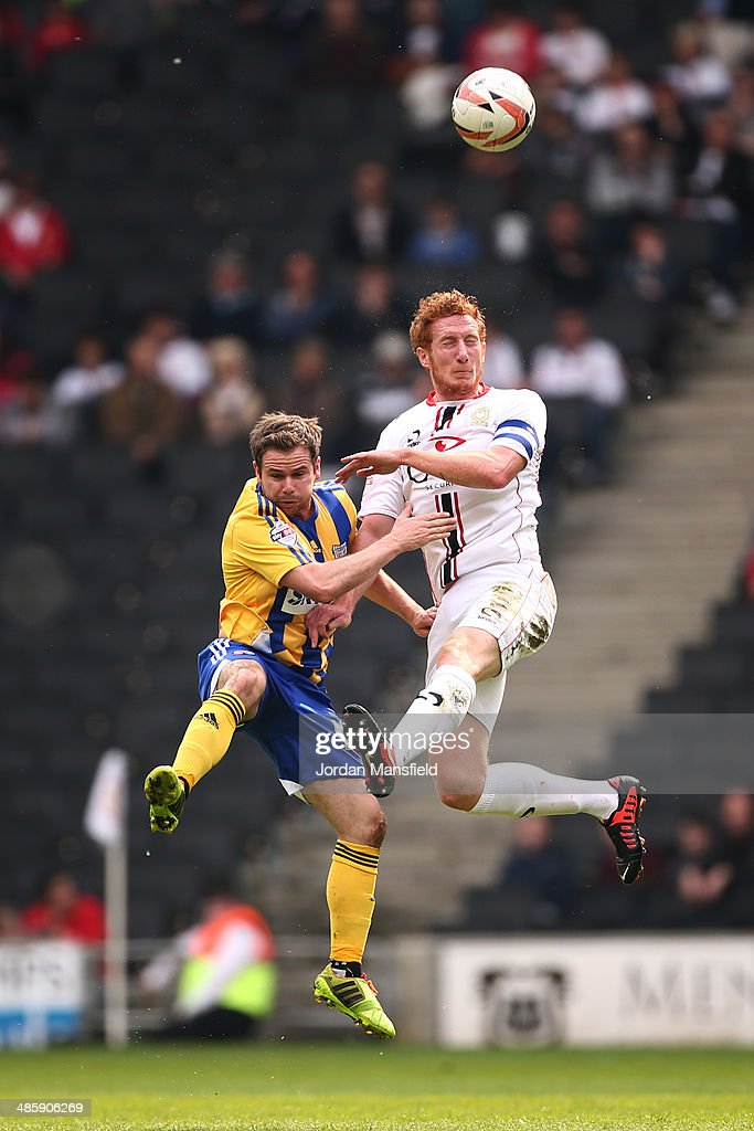 Dean Lewington of MK Dons battles in the air with Alan Judge of Brentford FC during the Sky Bet League One match between MK Dons and Brentford at Stadium mk on April 21, 2014 in Milton Keynes, England.
