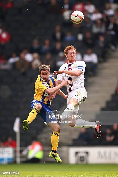 Dean Lewington of MK Dons battles in the air with Alan Judge of Brentford FC during the Sky Bet League One match between MK Dons and Brentford at...