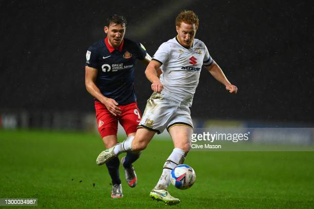 Dean Lewington of MK Dons gets away from Charlie Wyke of Sunderland during the Papa Johns Trophy match between Milton Keynes Donsd and Sunderland on...