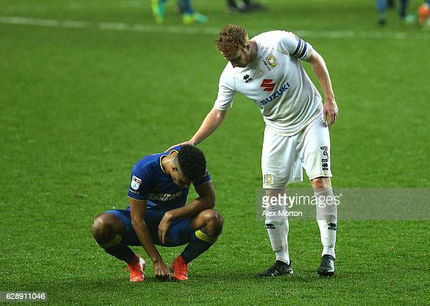 Dean Lewington of MK Dons pats Lyle Taylor of AFC Wimbledon after the final whistle during the Sky Bet League One match between Milton Keynes Dons...