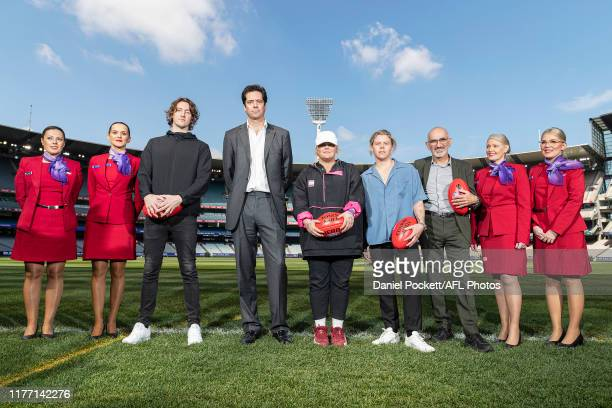 Dean Lewis, Gillon McLachlan, Tones & I, Conrad Sewell and Paul Kelly pose for a photo during the 2019 AFL Grand Final Entertainment Announcement at...