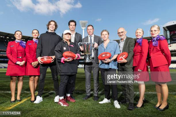 Dean Lewis, Tones & I, Gillon McLachlan, Steve Johnson, Conrad Sewell and Paul Kelly pose for a photo with the 2019 AFL Premiership Cup, during the...