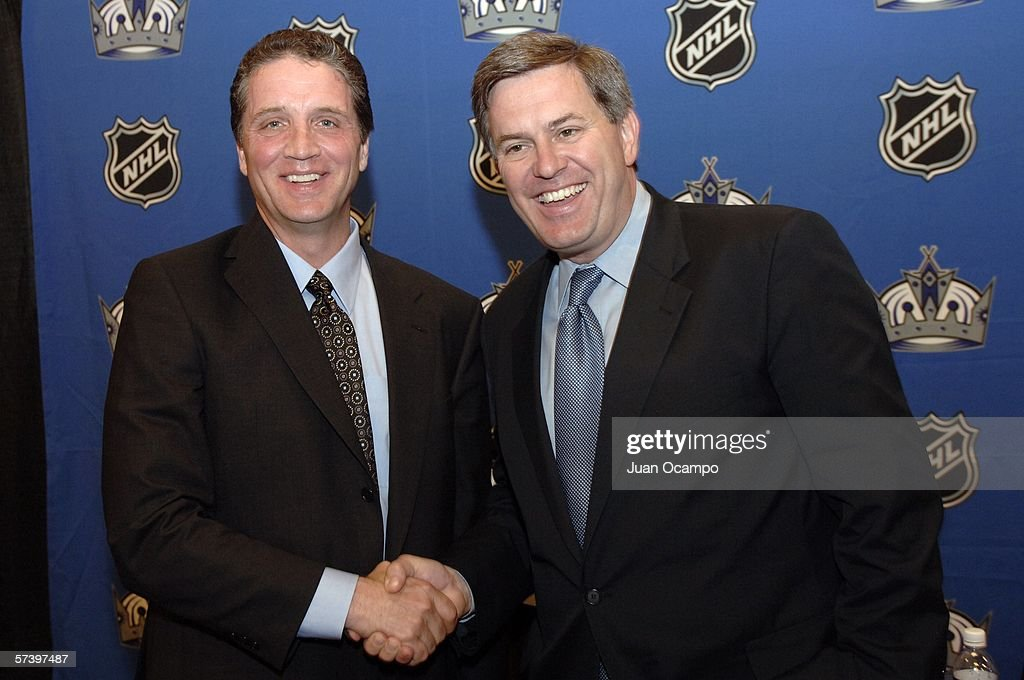 Dean Lombardi (L) and Los Angeles Kings Governor Tim Leiweke shake hands during a press conference announcing Lombardi as the new President and General Manager of the Kings on April 21, 2006 at the Toyota Sports Center in El Segundo, California.