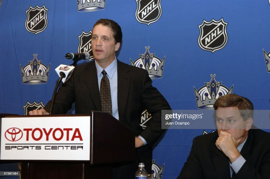 Dean Lombardi (L) speaks at a press conference announcing him as the new President and General Manager of the Los Angeles Kings as Kings Governor Tim Leiweke listens on April 21, 2006 at the Toyota Sports Center in El Segundo, California.