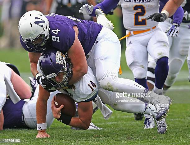 Dean Lowry of the Northwestern Wildcats drops Trenton Norvell of the Western Illinois Leathernecks on September 20 2014 at Ryan Field in Evanston...