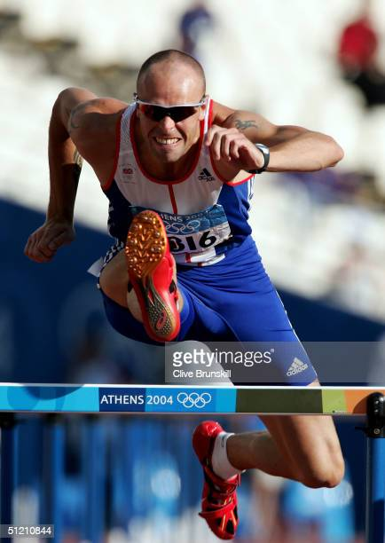 Dean Macey of Great Britain competes in the 110 metre hurdle discipline of the men's decathlon on August 24, 2004 during the Athens 2004 Summer...