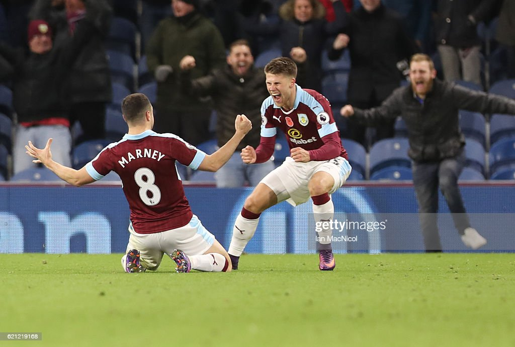 Dean Marney and Johann Guomundsson of Burnley celebrates their teams winning goal during the Premier League match between Burnley and Crystal Palace at Turf Moor on November 5, 2016 in Burnley, England.