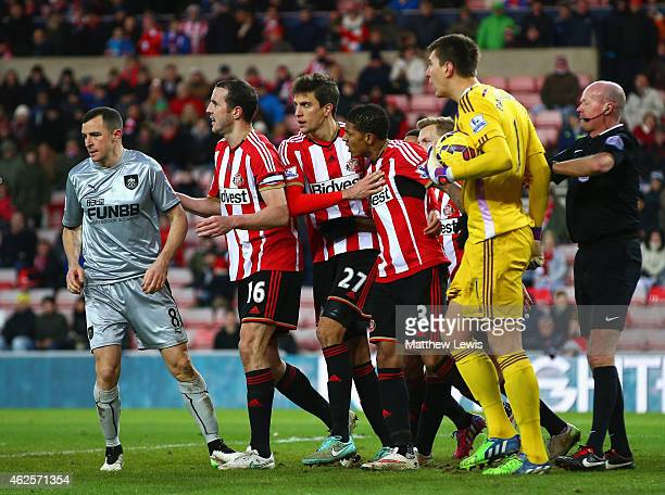 Dean Marney of Burnley clashes with Costel Pantilimon of Sunderland during the Barclays Premier League match between Sunderland and Burnley at...