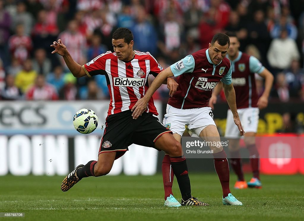 Dean Marney of Burnley in action with Jack Rodwell of Sunderland during the Barclays Premier League match between Burnley and Sunderland at Turf Moor on September 20, 2014 in Burnley, England.