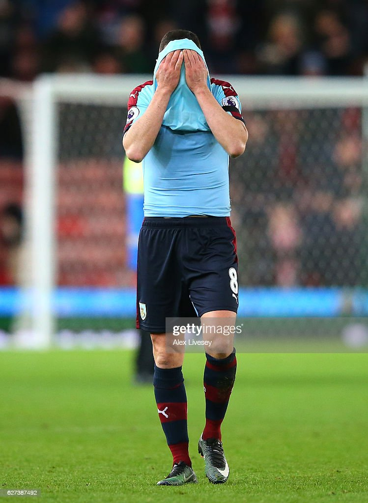 Dean Marney of Burnley show his dejection after his team's 0-2 defeat in the Premier League match between Stoke City and Burnley at Bet365 Stadium on December 3, 2016 in Stoke on Trent, England.