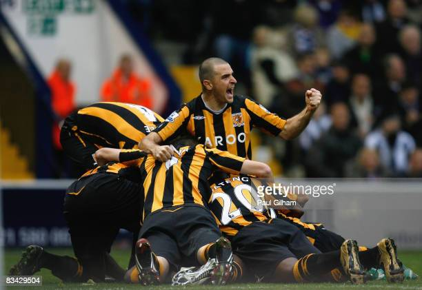 Dean Marney of Hull City celebrates with his team-mates after Zamil Zayette of Hull City scored the first goal for Hull City during the Barclays...