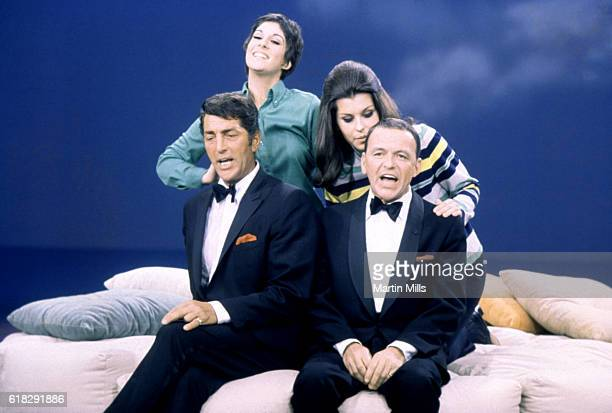 """Dean Martin and Frank Sinatra sing with their daughters Deana Martin and Tina Sinatra during the taping of """"The Dean Martin Variety Show"""" circa 1967..."""