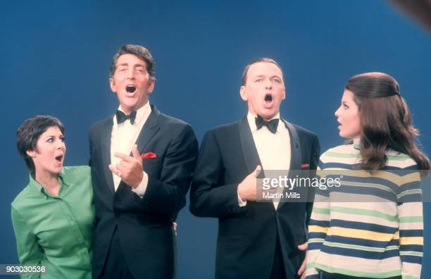 Dean Martin and Frank Sinatra sing with their daughters Deana Martin and Tina Sinatra during the taping of 'The Dean Martin Variety Show' circa 1967...
