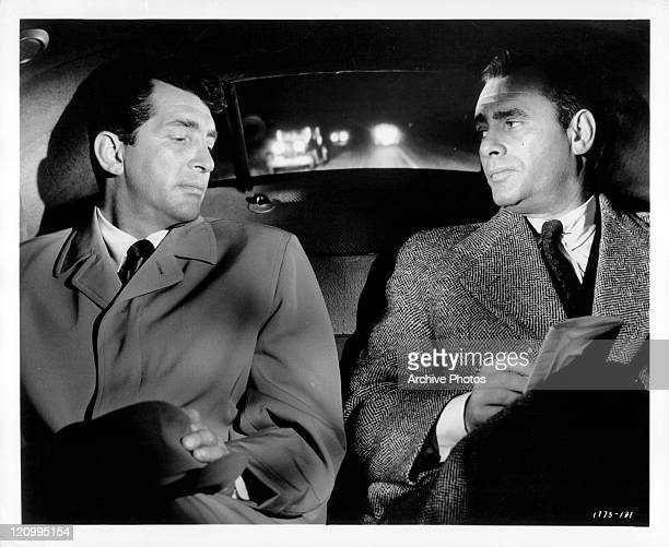 Dean Martin and Martin Balsam sitting in the back of the car in a scene from the film 'Ada' 1961