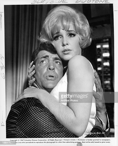Dean Martin and Stella Stevens holding onto to each other in despair in a scene from the film 'How To Save A Marriage And Ruin Your Life' 1962