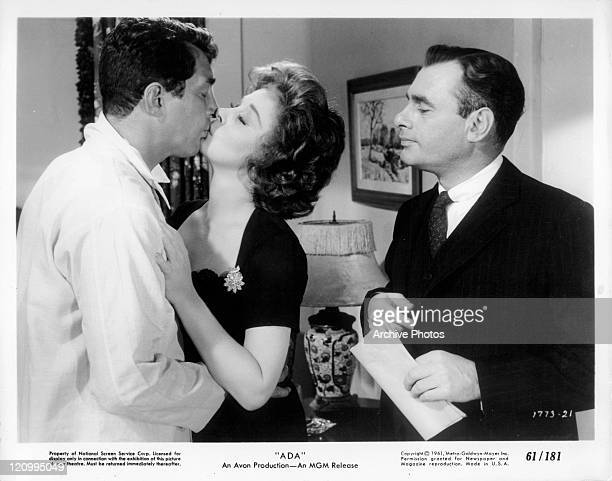 Dean Martin and Susan Hayward kiss in front of Martin Balsam in a scene from the film 'Ada' 1961