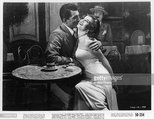 Dean Martin getting up close to Corinne Calvet in a scene from the film 'My Friend Irma Goes West' 1950