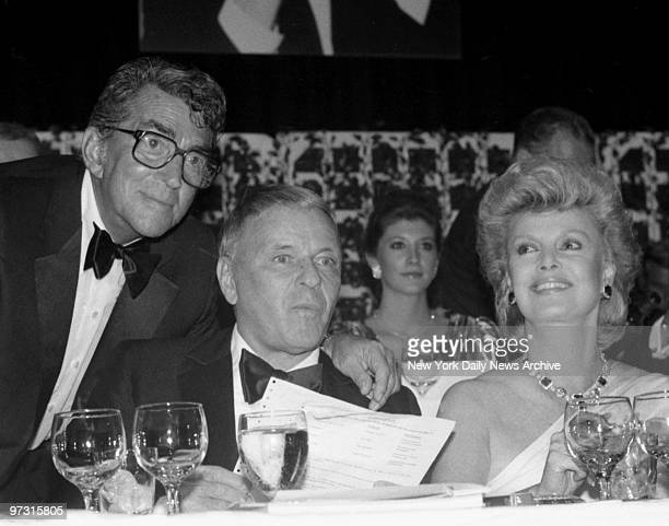 Dean Martin is honored at Friars Roast and with him is Frank Sinatra and his wife Barbara who are enjoying the party Sinatra skipped the traditional...