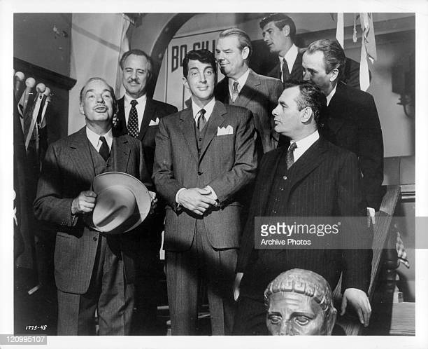Dean Martin surveys the festivities while Martin Balsam watches him in a scene from the film 'Ada' 1961