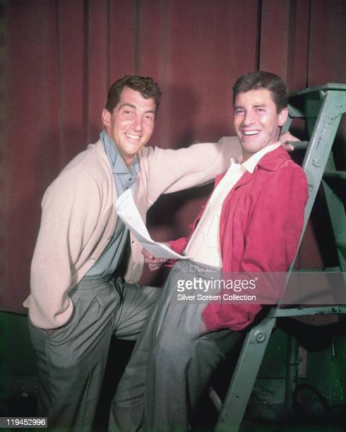 Dean Martin US actor and singer with Jerry Lewis US actor and comedian smiling in a studio portrait with Lewis holding a script while leaning against...