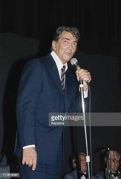 Dean Martin US singer and actor singing into a microphone at the Variety Club luncheon held in his honour at the Hilton Hotel in London England...
