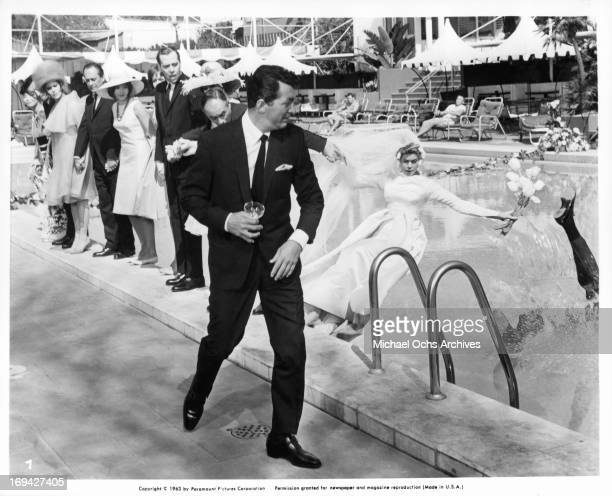 Dean Martin watches as Elizabeth Montgomery is pulled into pool with Jack Soo Jill St John Carol Burnett and Martin Balsam soon to fall thereafter in...