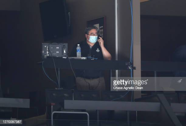 Dean Matsuzaki of NHL Events oversees Game Five of the Eastern Conference Second Round of the 2020 NHL Stanley Cup Playoff between the Boston Bruins...