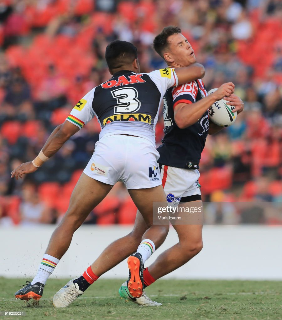 Dean Matterson of the Roosters (R) is tackled by Tyrone Peachey of the Panthers during the NRL trial match between the Penrith Panthers and the Sydney Roosters at Penrith Stadium on February 17, 2018 in Sydney, Australia.
