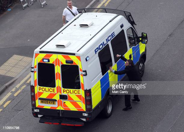 Dean Mayo a friend of Sian O'Callaghan's boyfriend Kevin Reape attacks a police van carrying Christopher Halliwell into Swindon Magistrates on March...