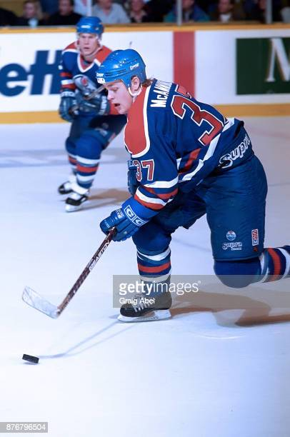 Dean McAmmond of the Edmonton Oilers skates against the Toronto Maple Leafs during NHL game action on December 23 1995 at Maple Leaf Gardens in...
