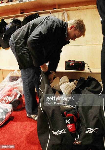 Dean McAmmond of the New Jersey Devils packs his gear following the Devils first round exit in the playoffs at the Prudential Center on April 26 2010...