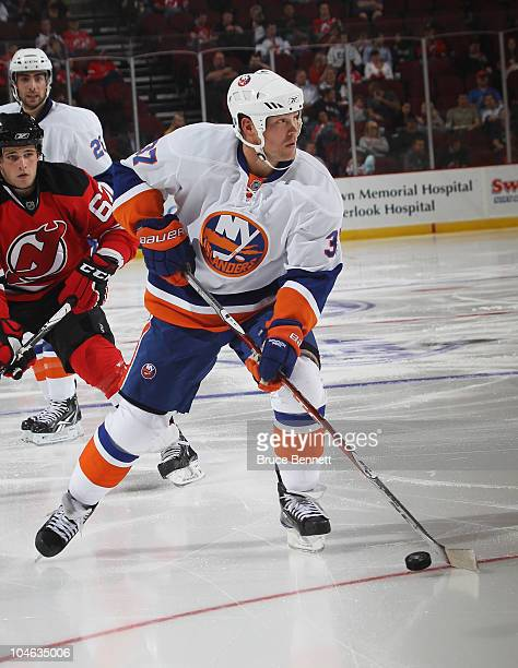 Dean McAmmond of the New York Islanders skates against the New Jersey Devils at the Prudential Center on October 1 2010 in Newark New JerseyThe...