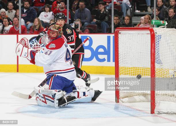 Dean McAmmond of the Ottawa Senators looks on as the puck gets behind Jaroslav Halak of the Montreal Canadiens for a third period goal at Scotiabank...
