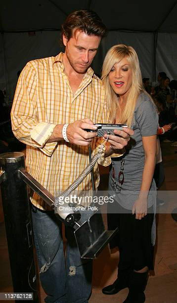 Dean McDermott and Tori Spelling during Sony Computer Entertainment America and the Bruce Willis Foundation Present Playstation BANDtogether Inside...