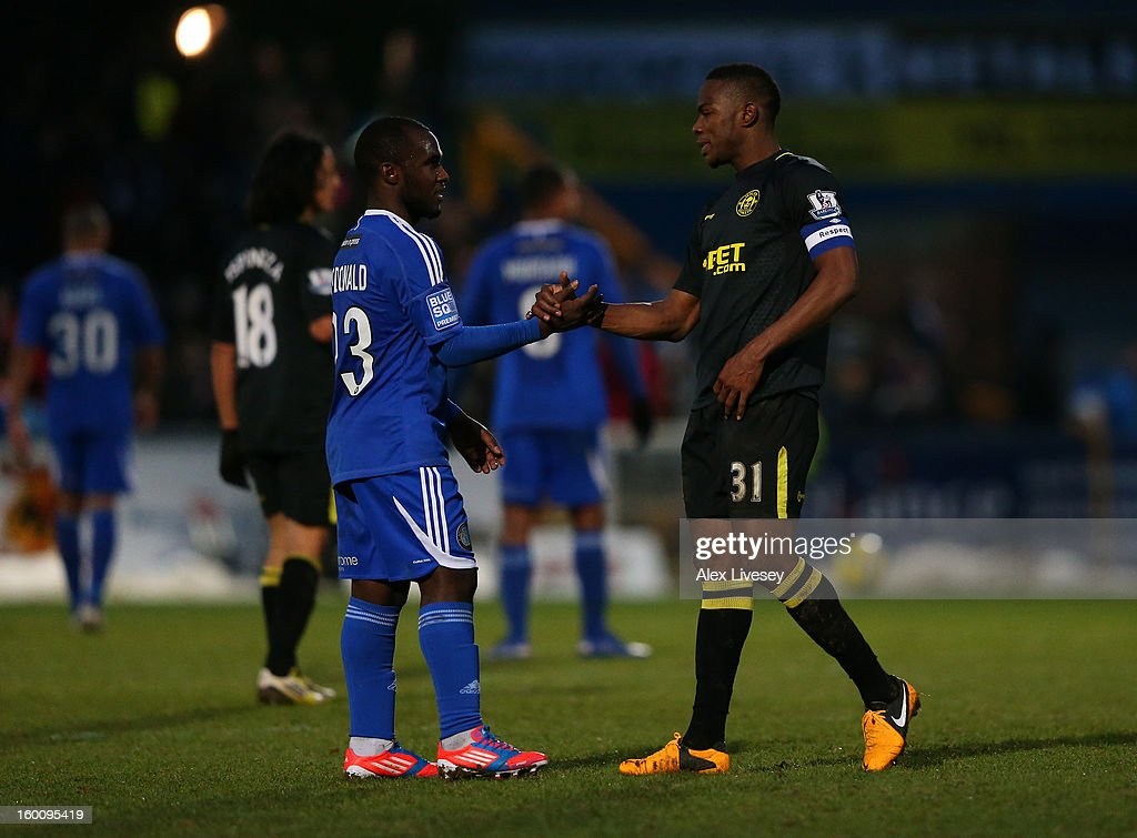 Dean McDonald of Macclesfield Town shakes hands with Maynor Figueroa of Wigan Athletic during the Budweiser FA Cup fourth round match between Macclesfield Town and Wigan Athletic at Moss Rose Ground on January 26, 2013 in Macclesfield, England.