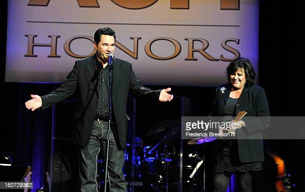 Dean Miller and Mary Arnold accept the Poet's Award on behalf of the late Roger Miller at the 6th Annual ACM Honors at Ryman Auditorium on September...