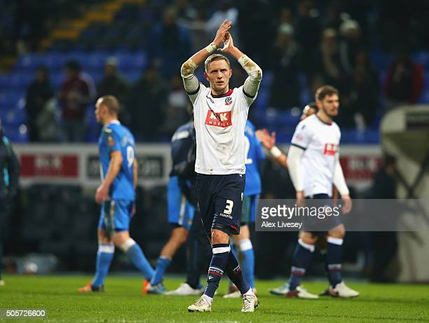 Dean Moxey of Bolton Wanderers applauds the supporters after his team's 32 win in the Emirates FA Cup Third Round Replay match between Bolton...