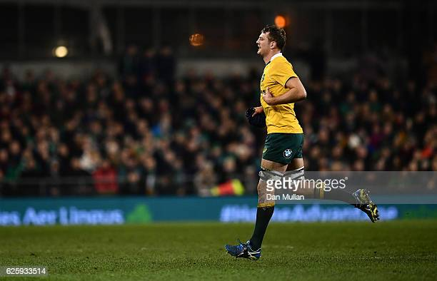 Dean Mumm of Australia leaves the field after being shown a yellow card by Referee Jerome Garces during the international match between Ireland and...