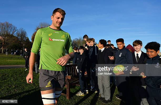 Dean Mumm of Australia makes his way to the pitch past a group of school boys during an Australia training session at Harrow School on November 28...