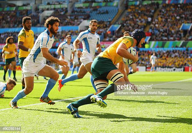 Dean Mumm of Australia scores their third try during the 2015 Rugby World Cup Pool A match between Australia and Uruguay at Villa Park on September...