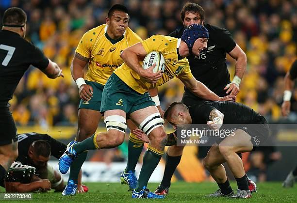 Dean Mumm of the Wallabies runs the ball during the Bledisloe Cup Rugby Championship match between the Australian Wallabies and the New Zealand All...