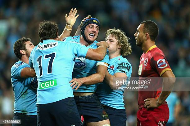 Dean Mumm of the Waratahs celebrates scoring a try during the round 18 Super Rugby match between the Waratahs and the Reds at Allianz Stadium on June...