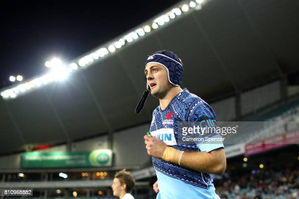 Dean Mumm of the Waratahs runs onto the field for his final home match during the round 16 Super Rugby match between the Waratahs and the Jaguares at...