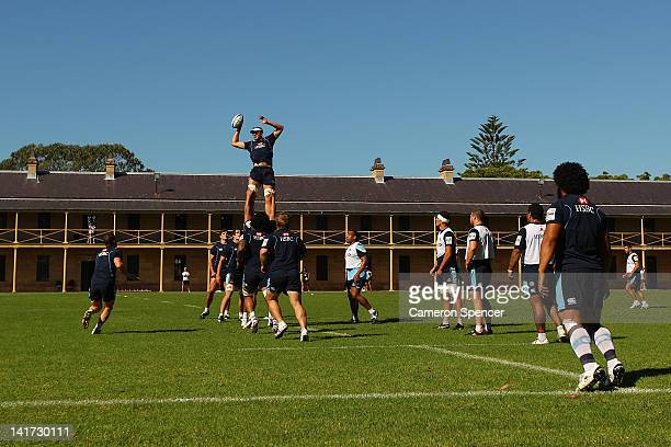 Dean Mumm of the Waratahs takes a lineout ball during a Waratahs Super Rugby training session at Victoria Barracks on March 23 2012 in Sydney...