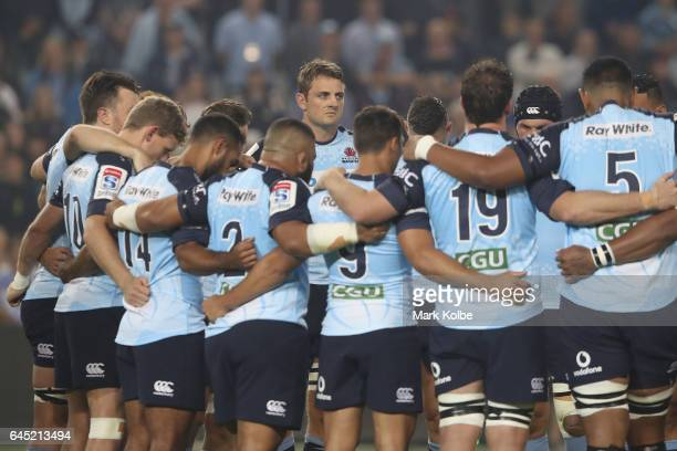 Dean Mumm of the Waratahs watches on as the Waratahs stand in their huddle huddle for a minute silence in honour of former Wallaby and Waratah Dan...