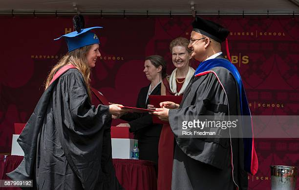 Dean Nitin Nohria of the Harvard Business School presenting her diploma to Amaris Singer during Commencement Ceremonies in Boston MA on May 29 2014