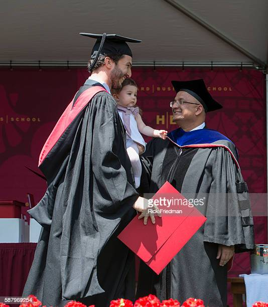 Dean Nitin Nohria of the Harvard Business School presenting his diploma to Sergio Merino Gonzalez with his daughter Lucia during Commencement...