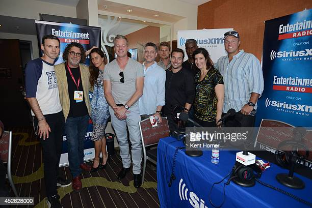 Dean Norris Mike Vogel Rachelle Lefevre Eddie Cahill Alex Koch Mackenzie Lintz and Colin Ford pose with radio hosts Dalton Ross and Jessica Shaw...